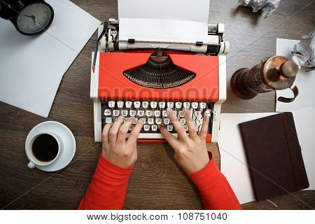 Vintage red typewriter with blank paper