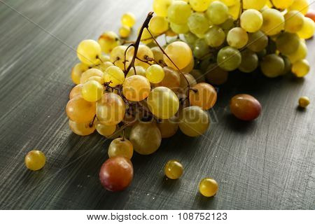 Juicy green grapes, on wooden background