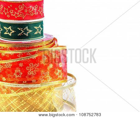 Coils Of Shiny Ribbons Isolated Over White.