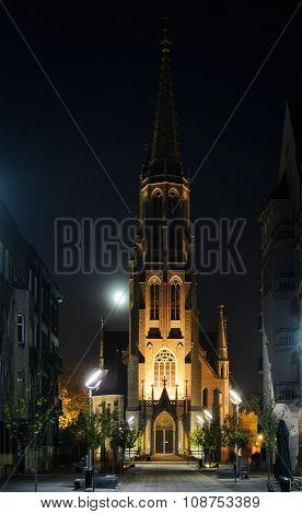 Mariacki Church In Katowice With Moon In The Night.