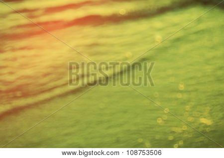 Blur Beach With Bokeh Sun Light Abstract Background.