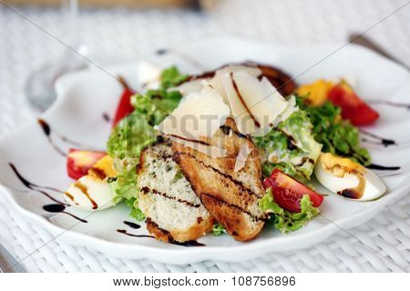 Tasty salad on white served table, outdoors