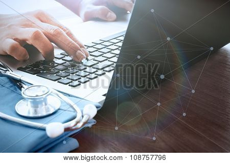 Doctor Hand Working With Laptop Computer In Medical Workspace Office As Concept