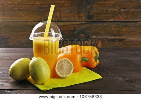 Fresh vegetable juice on wooden background