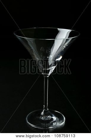 Empty glass on black background