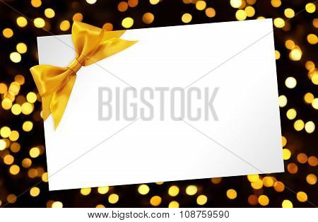 Blank Card With Bow In Golden Lights Background