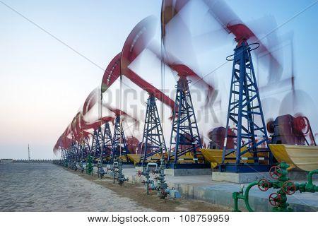 working oil-rig in oilfield in clear sky
