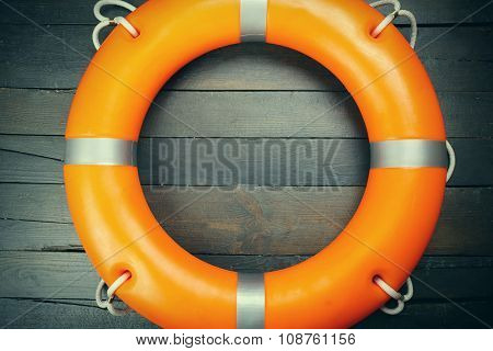 A life buoy on wooden wall