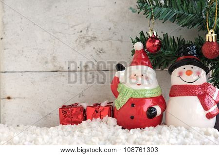 Santa Claus And Snowman On The Snow With Christmas Tree In Vintage Background