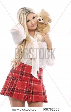 Beautiful blonde plays with Teddy bear.