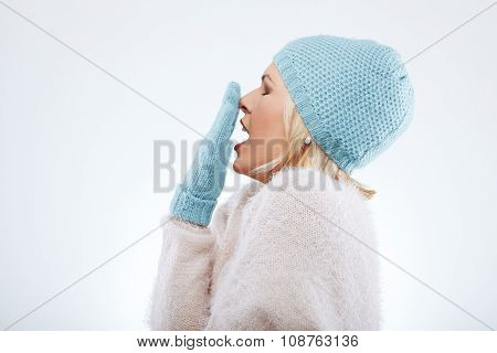 Sleepy Woman In Winter Clothes