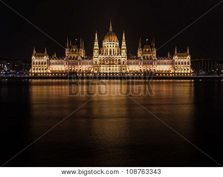 The Parliament Of Budapest Reflecting In The Danube River At Night