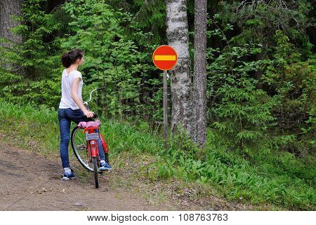 Girl and traffic sign.