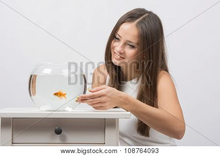 The Girl Is Very Much Like A Goldfish In An Aquarium