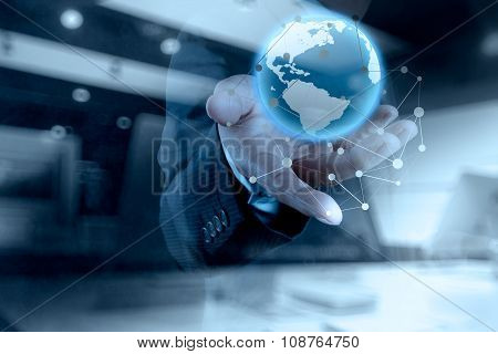 Double Exposure Of Businessman Working With New Modern Computer Show Globe With Social Network Struc