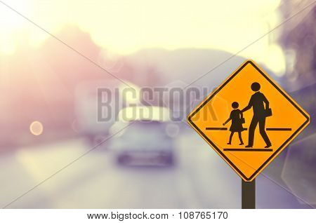 Traffic Sign Road On Blur Road Abstract Background.
