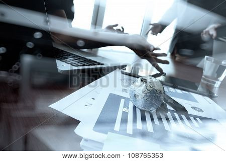 Business Documents On Office Table With Smart Phone And Digital Tablet And Laptop Computer And Two C