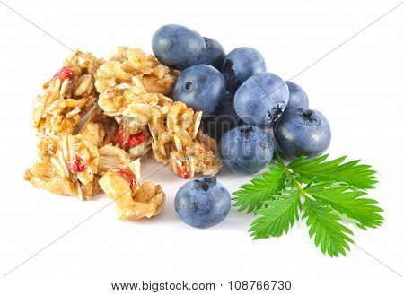 Blueberries with honey roasted cereal chunks on white background