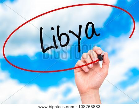 Man Hand writing Libya with black marker on visual screen.