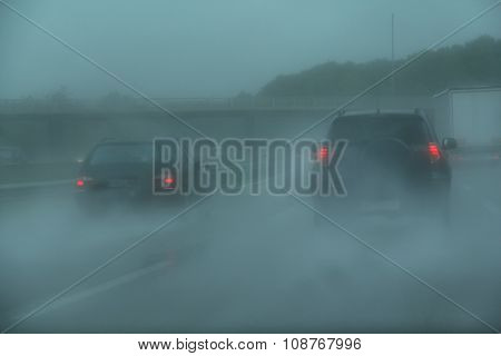 Traffic on the motorway in a rainy day