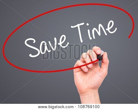 Man Hand writing Save Time with black marker on visual screen.