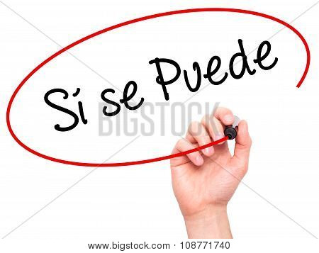 Man Hand writing Si se puede( Yes, it is possible in spanish) with black marker on visual screen.