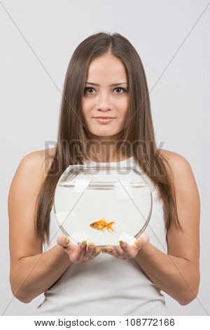 Joyful Young Girl With An Aquarium With Goldfish In Hands