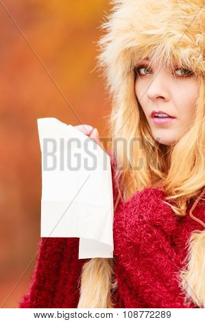 Sick Woman In Autumn Park Sneezing Into Tissue.