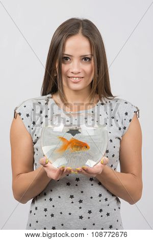 Young Happy Girl Holding A Fish Tank With Goldfish