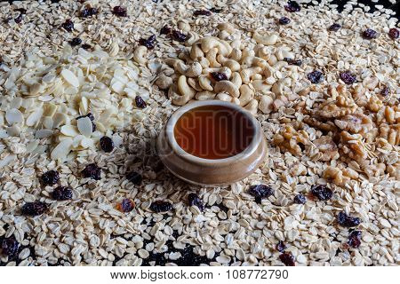 Granola ingredients from side with honey