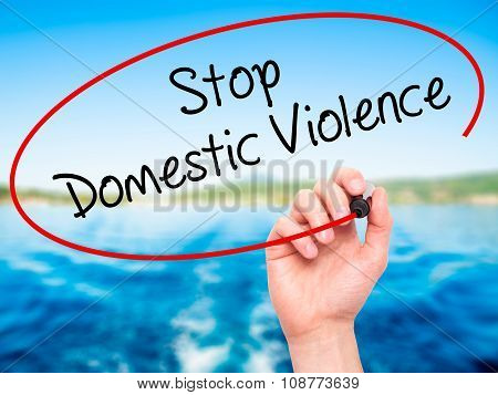 Man Hand writing Stop Domestic Violence with black marker on visual screen.