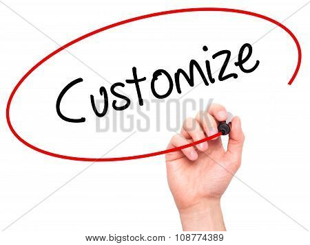 Man Hand writing Customize with black marker on visual screen.