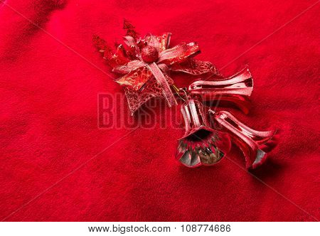 Xmas bells on red background.