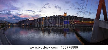 VIew basilica the fourviere and the passerelle du palais de justice over the saone at sunset at Lyon, France