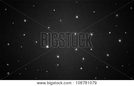 black background with a scattering of diamonds