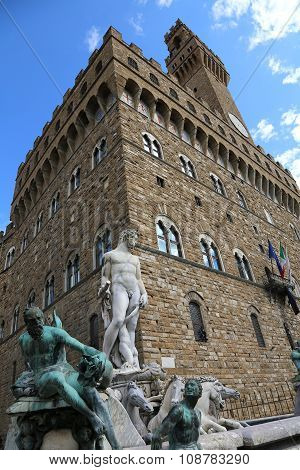 White Statue Of Neptune In The Ancient Fountain In Florence And Palazzo Vecchio