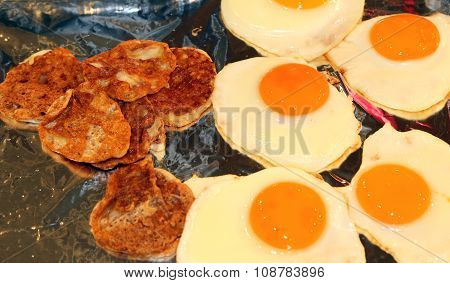 Fried Eggs With Slices Of Salami For Breakfast