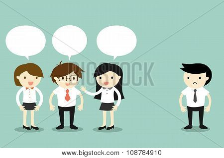 Two business women talking with businessman, but another business man standing alone.