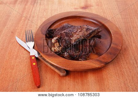 fresh roast beef barbecue on wood with cutlery over table bbq