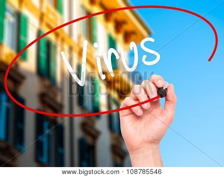 Man Hand writing Virus with black marker on visual screen.