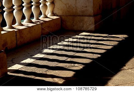 Ancient Marble Balustrade With Pillars  And The Shadow