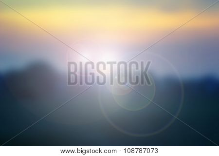 Natural Background Blurring.warm Colors And Bright Sun Light. Bokeh Background Or Christmas Backgrou