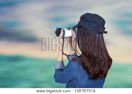Woman Traveler Wearing Blue Dress As Photographer, Take Photo With Camera Outdoor