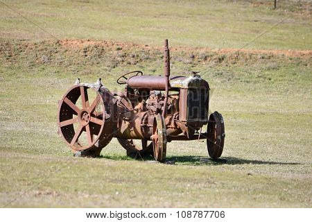 Old rusty abandoned tractor
