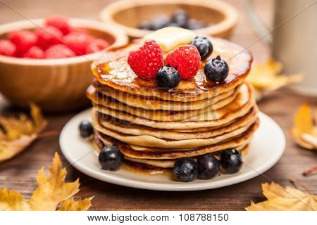 High pile of delicious pancakes with blueberry