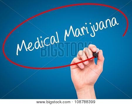 Man Hand writing Medical Marijuana with black marker on visual screen