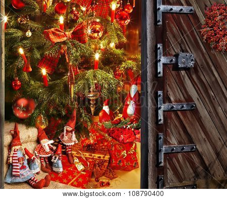Great door opening in a room with decorated christmas tree and gift on christmas evening