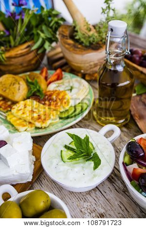 Greek cuisine dishes -  tzatziki, choriatiki, halloumi