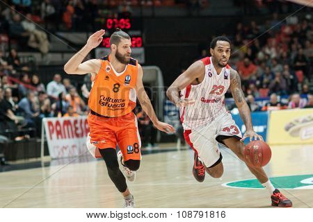 VALENCIA, SPAIN - NOVEMBER 18th: Kitchen (R) witj ball and Diot (L) during Eurocup between Valencia Basket Club and Sluc Nancy at Fonteta Stadium on November 18, 2015 in Valencia, Spain