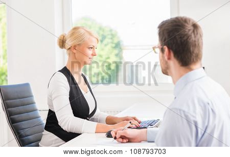 Beautiful woman consulting a man in the office.